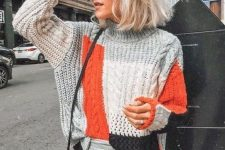 a color block sweater, grey thin strip pants, a black bag for a cool and bold winter outfit with some color
