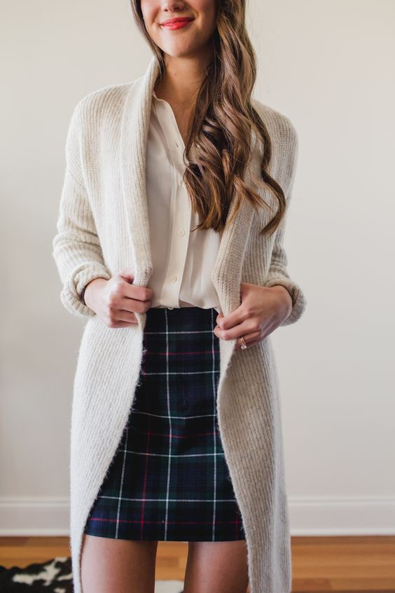 a cozy and simple winter look with a white shirt, a plaid mini skirt, a neutral long cardigan is a cool idea