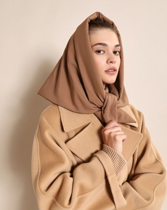 a cozy monochromatic look with a tan oversized coat, a brownheadscarf for a chic and warm winter look