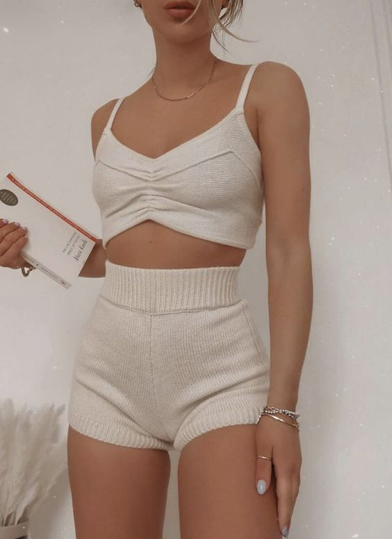 a creamy two-piece knit set with a crop top and high waisted shorts is a great set to wear at home