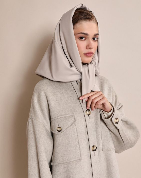 a dove grey headscarf paired with a woolen blazer-like jacket for a super trendy look in monochromatic colors