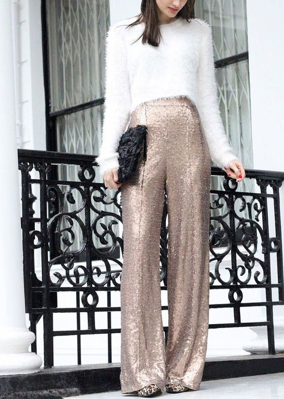 a fuzzy cropped sweater, gold sequin palazzo pants, leopard print shoes and a black clutch to sparkle