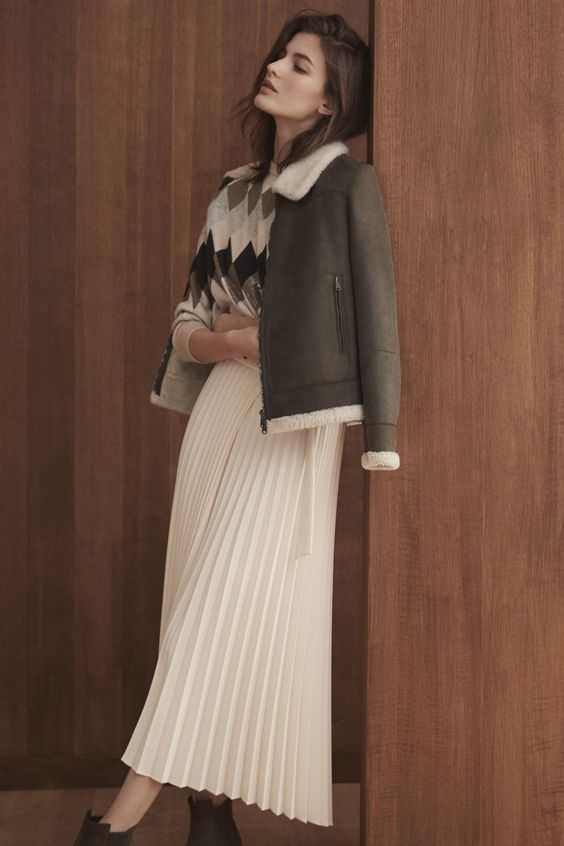 a geometric print sweater, a white pleated midi, a crown and white shearling jacket and boots