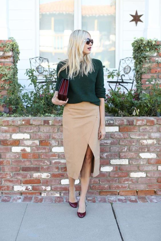 a green sweater, a tan suede wrap midi skirt, purple shoes and a purple bag for a catchy and bold look