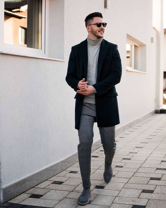 a grey turtleneck, grey pants, navy shoes and a black short coat for a warm winter day