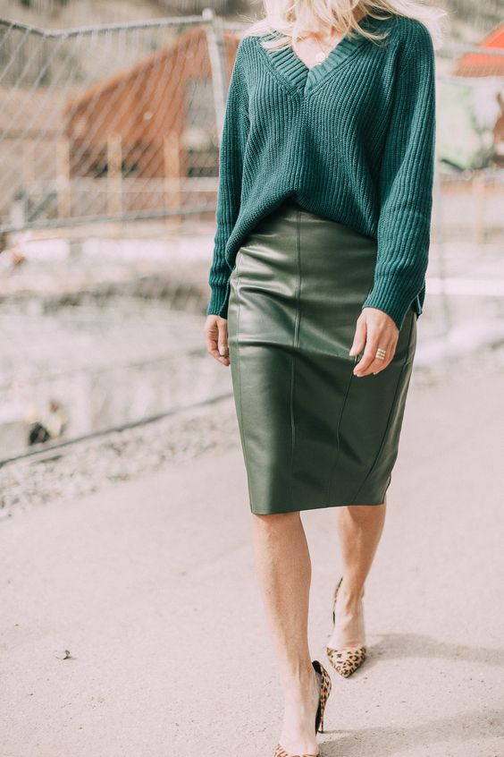 a hunter green oversized sweater, a green leather midi, leopard print shoes for a holiday work look