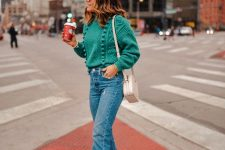 a light green pompom sweater, light blue jeans, white booties and a neutral bag for those who prefer lighter shades