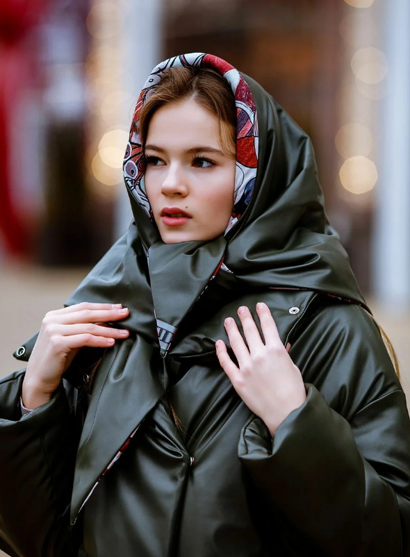 a manmade leather and colorful fabric headscarf paired with a leather puffer jacket for a super trendy look