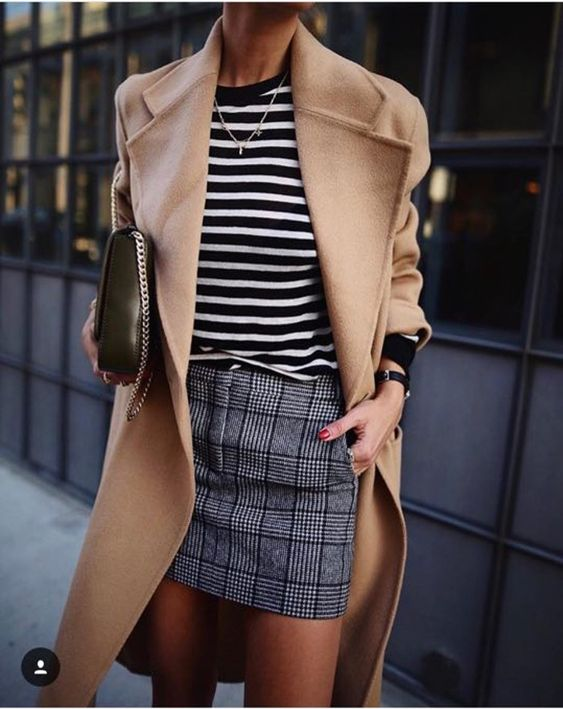 a mixed print look with a striped top, a plaid grey mini, a tan coat and a dark green bag on chain