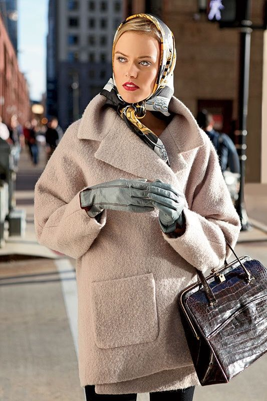 a neutral fuzzy short coat, a colorful printed headscarf and a burgundy crocodile leather bag for a chic look