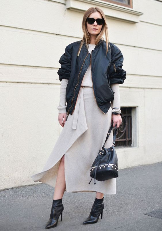 a neutral knit midi wrap dress, black booties, a black bomber jacket and a black bag for a chic look