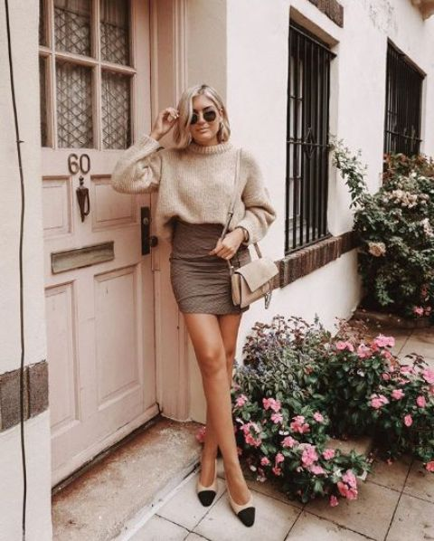 a neutral oversized sweater, a brown mini skirt, twon tone shoes and a tan bag for a wow look