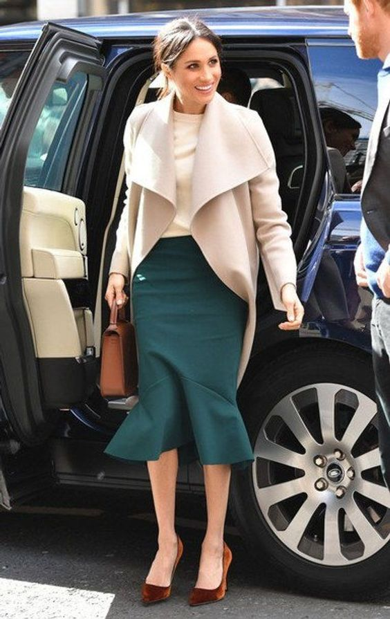 a neutral top, a green mermaid midi skirt, brown velvet shoes, a brown bag and a neutral coat for a chic office look