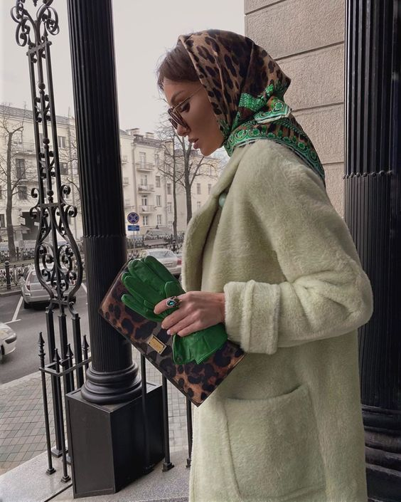 a pastel green faux fur coat, bright green gloves, a leopard clutch, a printed leopard and green headscarf