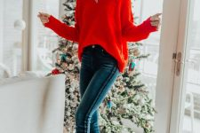 a red pompom sweater, navy skinnies and black heels for a lovely and traditional holiday look