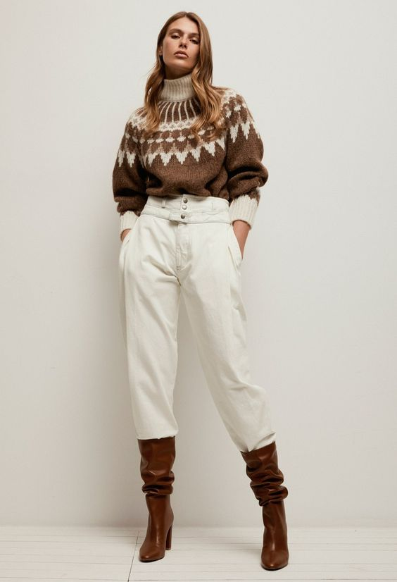 a retro-inspired turtleneck sweater, white high waisted jeans, brown boots for a cozy monochromatic look