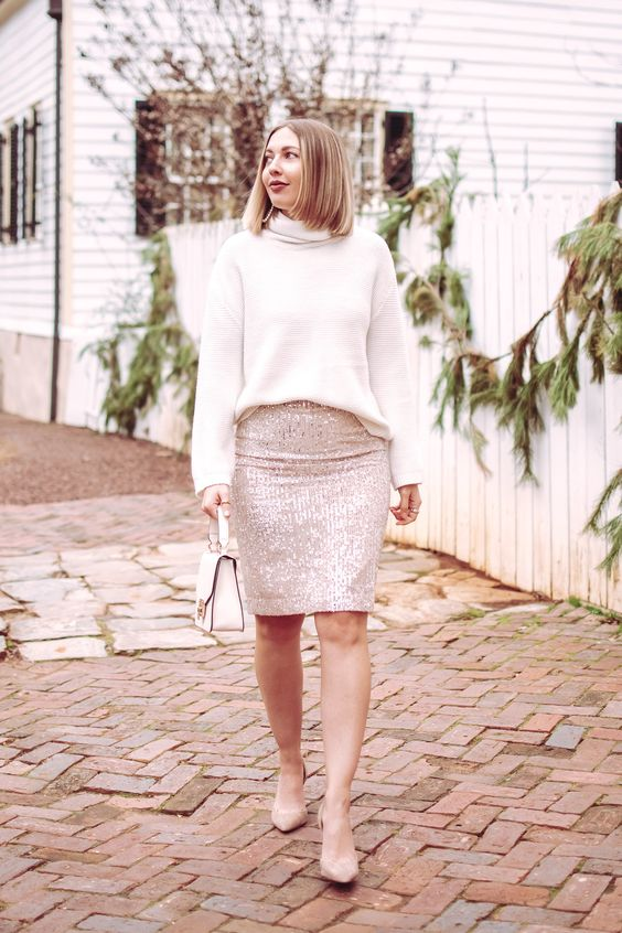 a simple and glam look with a white turtleneck, a shiny blush sequin knee skirt, nude shoes and a white bag