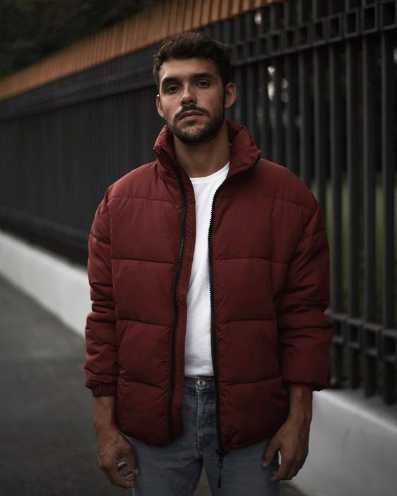 a simple look with a white tee, blue jeans, a burgundy puffer jacket with short sleeves for a warm winter