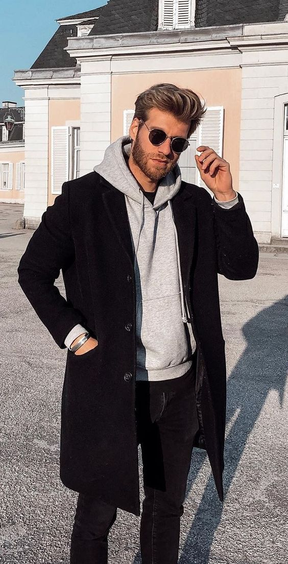a simple outfit with a black tee, a grey hoodie, a black coat and jeans is a timeless idea for winter