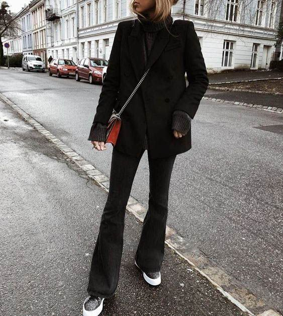 a simple winter look with a grey turtleneck sweater, a black blazer, black flare jeans, grey platform shoes and a red bag