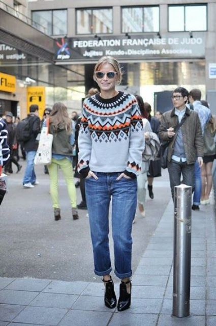 a stylish and bold look with a retro-inspired fair aisle sweater, blue jeans and black cutout booties