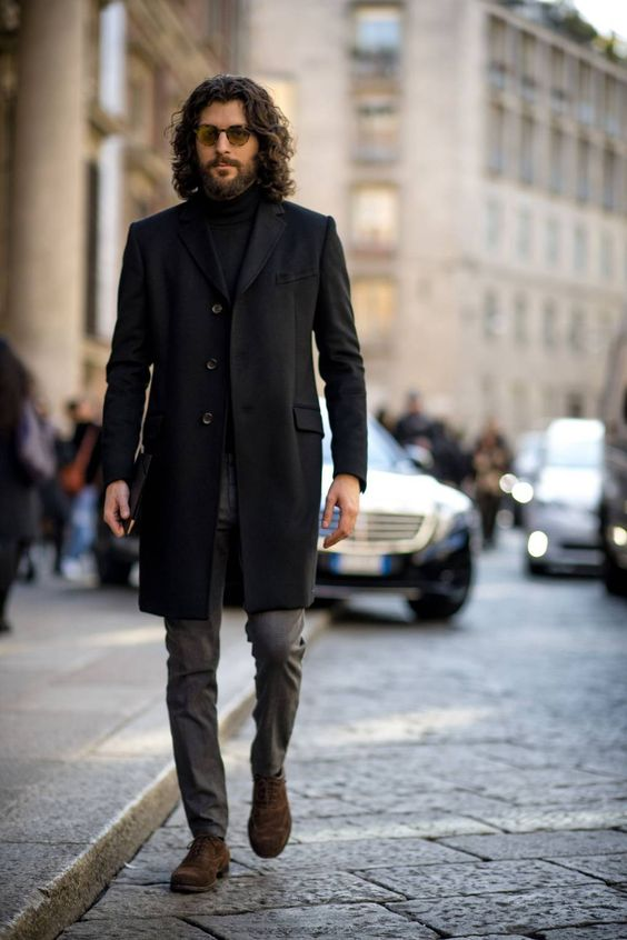 a stylish look with a black turtleneck, grey pants, brown shoes, a black coat will fit fall or winter