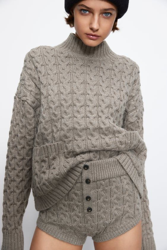 a super arm knit set of a high neckline sweater and shorts with cable knit   wear this sweater outside, too