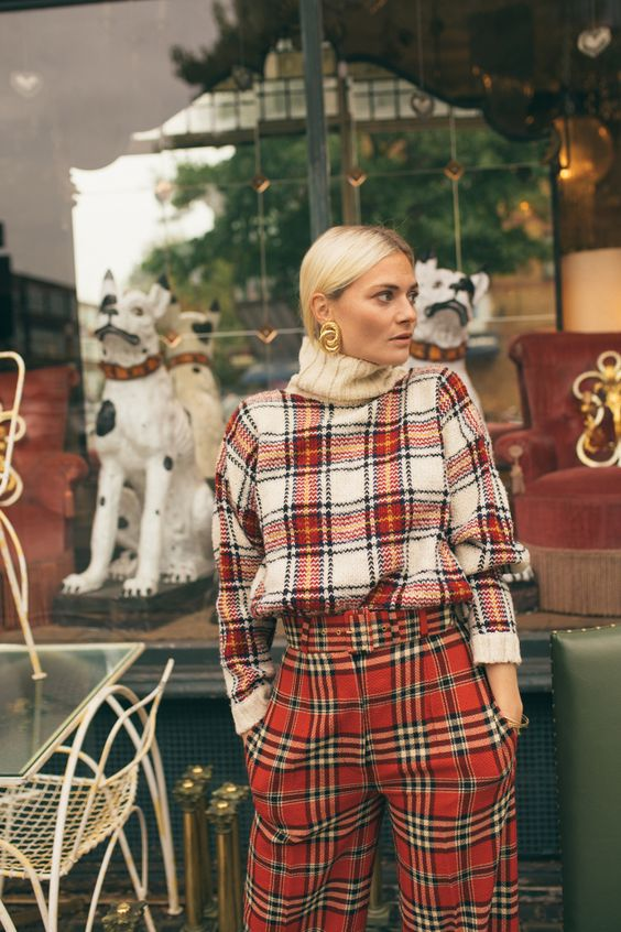 a super bold and creative double plaid look with an oversized sweater and pants that mismatch but look cool together