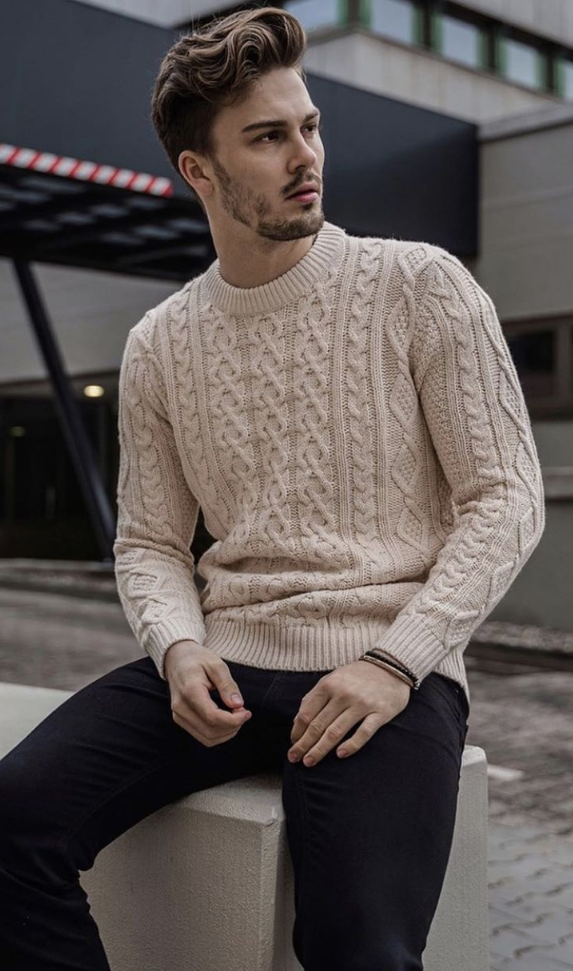 a tan cable knit high neckline sweater and black jeans are a simple combo for every winter day