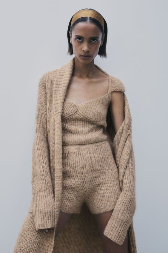 a taupe three piece knit set with a cap mini slee top, shorts and a long cardigan is a very cozy idea