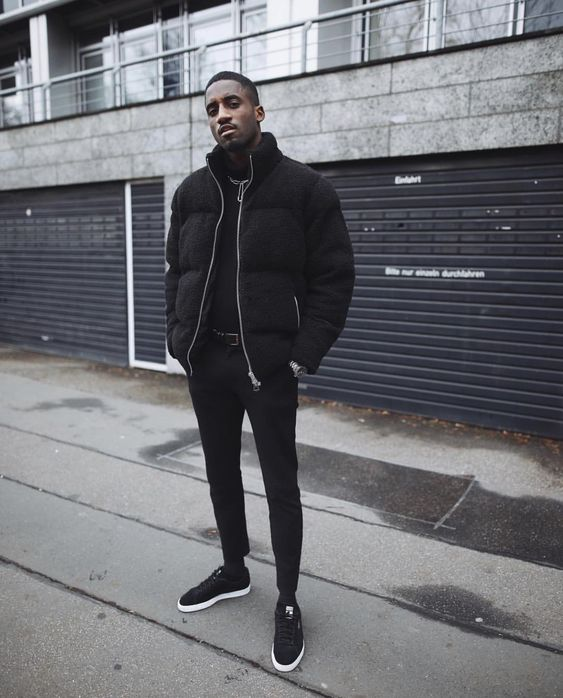 a total black look with pants, a sweatshirt, trainers and a puffer jacket is always in trend