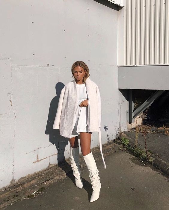 a total white look with a mini dress, a cozy warm mini coat, white knee high boots for winter