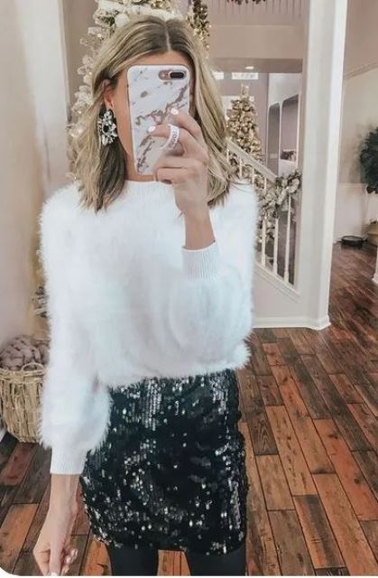 a white fuzzy sweater, a black sequin mini, statement earrings for a shiny and glam holiday party look
