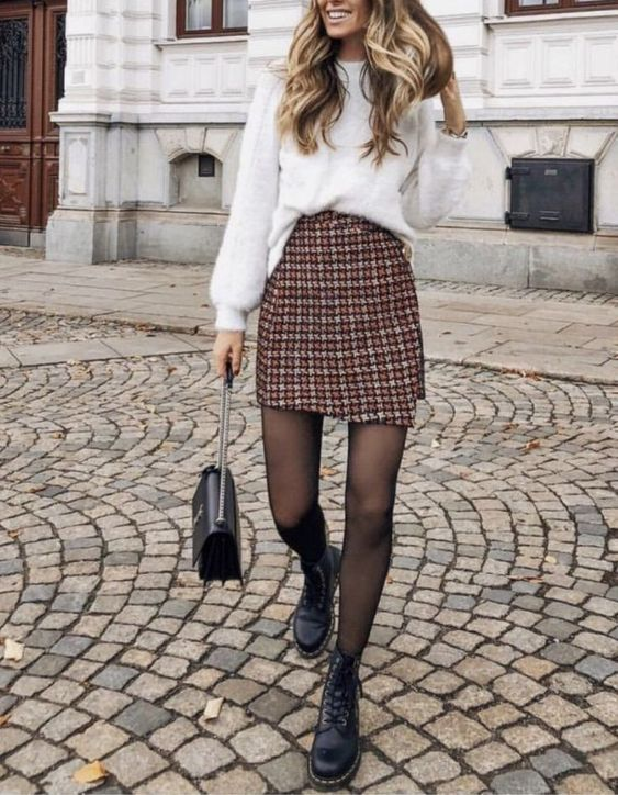 a white oversized sweater, a tweed wrap mini skirt, black combat boots, a black bag for winter