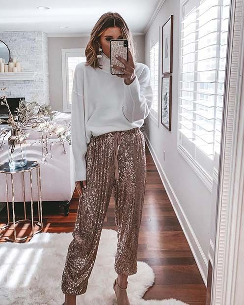 a white oversized sweater, rose gold sequin pants, nude shoes and statement earrings for Christmas