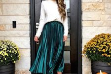 a white sweatshirt, a hunter green pleated midi skirt, leopard print shoes for a simple and stylish holiday look