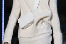 a white turtleneck sweater, a white sequin skirt and a small crossbody bag for a beautiful holiday look