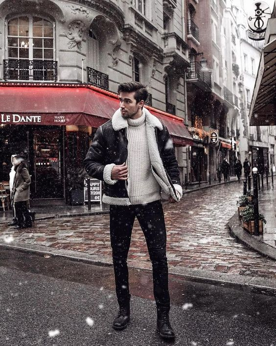 a white turtleneck sweater, black jeans, black boots, a black shearling jacket for a cozy feel