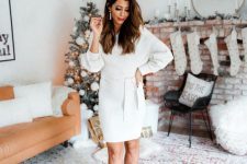 a white wrap mini dress with long sleeves and strappy shoes plus pearl earrings for a lovely Christmas outfit