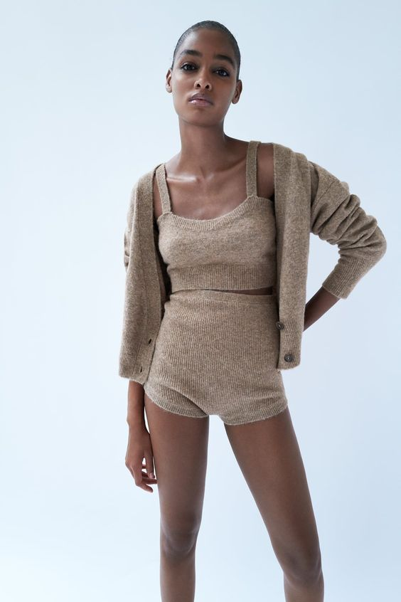 a woolen three-piece set with a crop top, a cardigan and high waisted shorts in a taupe shade