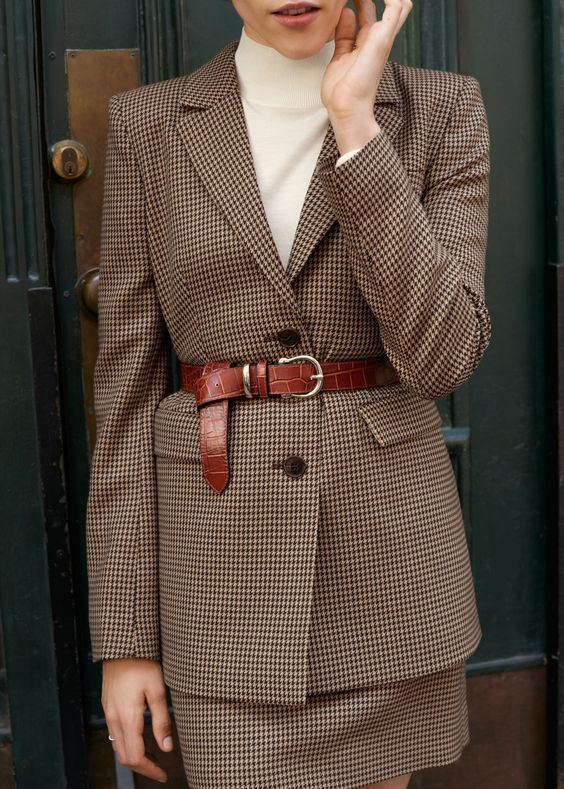 an elegant work outfit with a creamy turtleneck, a beige printed mini skirt suit and a brown snakeskin belt
