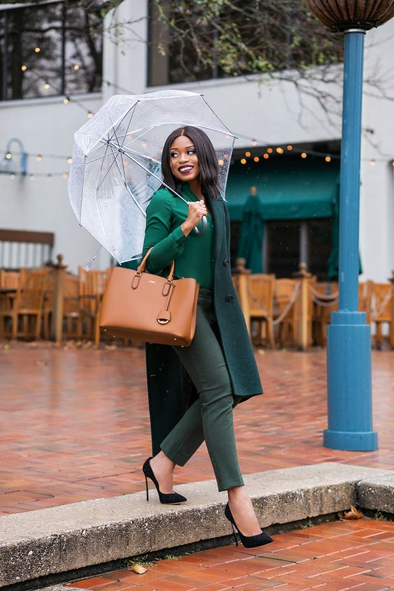 an emerald sweater, green pants, black shoes, a teal coat and a cognac tote for a chic winter holiday look