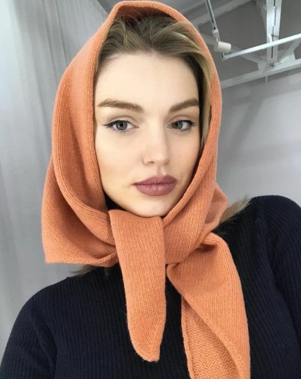 an orange woolen headscarf will keep you warm and will add color to your winter outfit