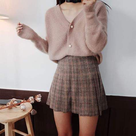 aperfectly chic and cozy look with a dusty pink oversized cardigan, a plaid mini skater skirt is a very cool idea