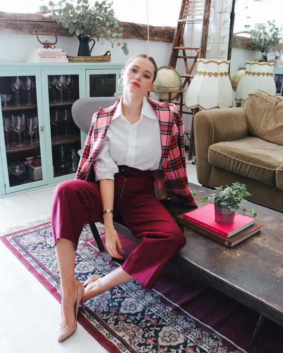 burgundy culottes, nude shoes, a white shirt, a plaid red and pink plaid blazer for a bold and cool look