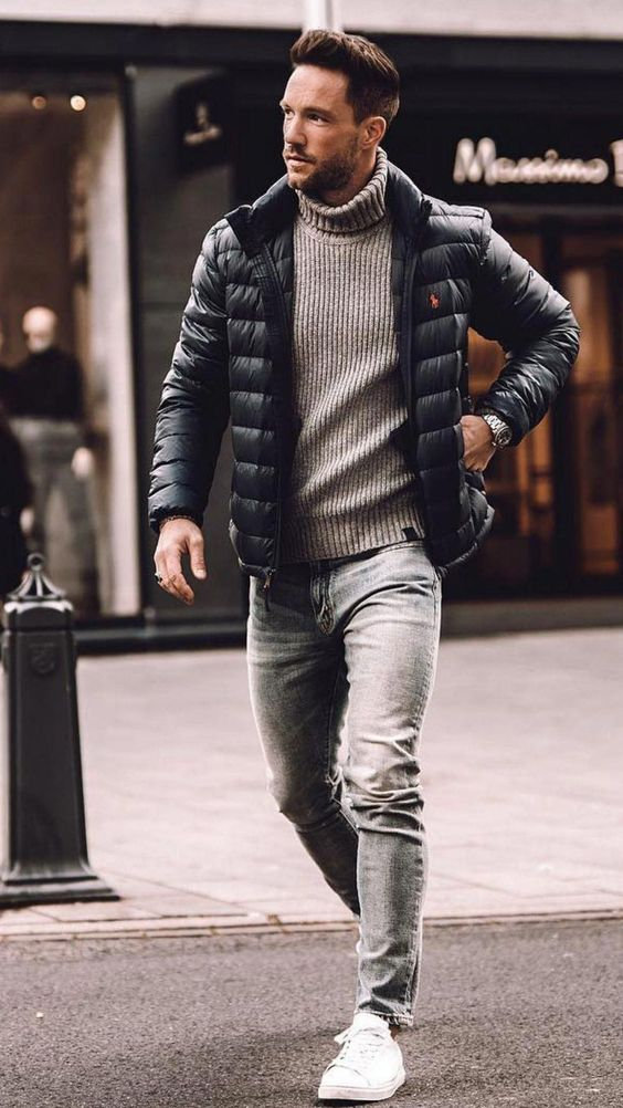 light blue jeans, a grey turtleneck sweater, a black puffer jacket and white sneakers for a casual winter look