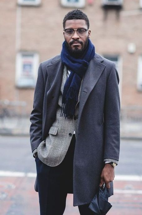 navy pants, a grey plaid blazer over a white shirt, a grey coat, a navy scarf for a stylish winter look