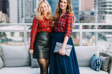 red plaid shirts worn with a leather mini and a navy A-line midi, red shoes and black booties for a bold look