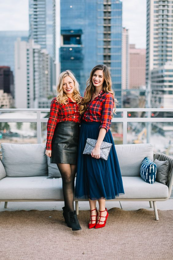 red plaid shirts worn with a leather mini and a navy A line midi, red shoes and black booties for a bold look