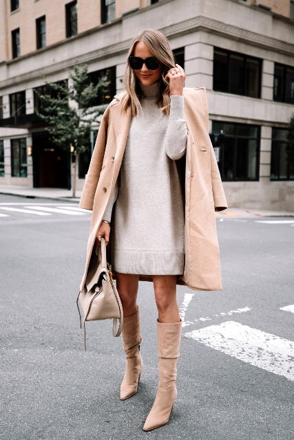 With beige coat, beige bag and beige high boots